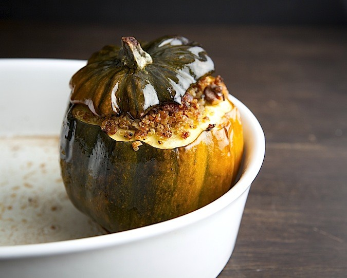 Acorn squash stuffed with pancetta, quinoa and walnuts