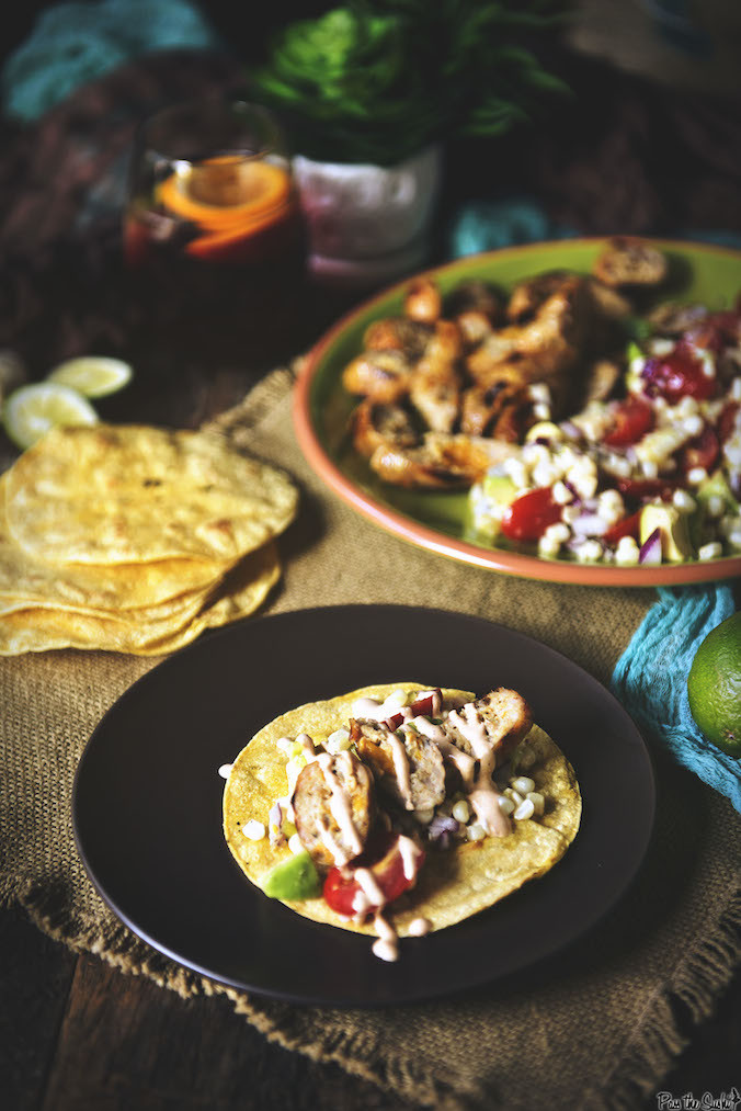 Grilled Mango Chicken Sausage with Avocado Corn Salad and Chipotle Cream