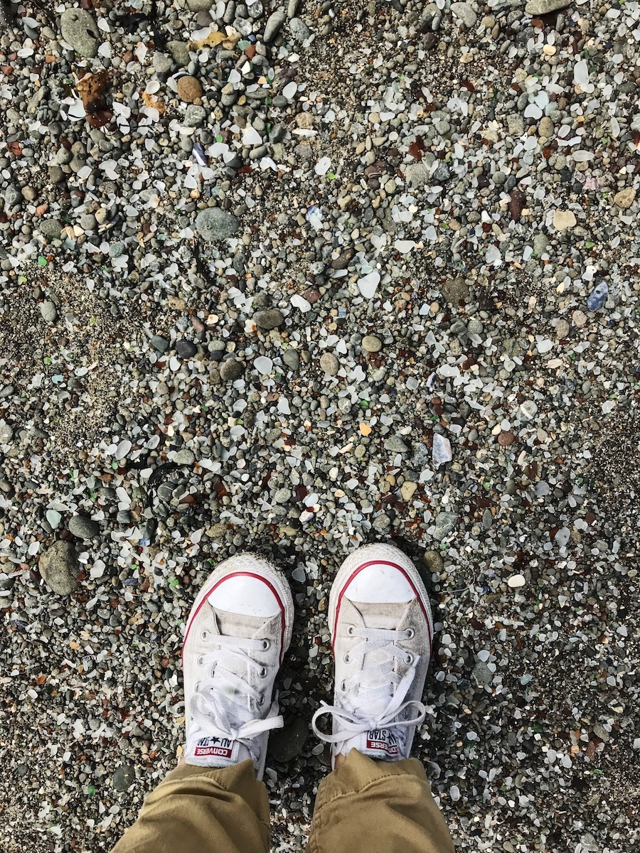 Mendocino beach with rocks and feet.